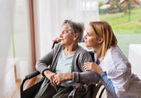 health-visitor-and-a-senior-woman-during-home-PTLWSR6